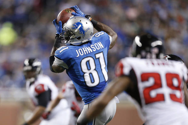Detroit Lions wide receiver Calvin Johnson (81) makes a reception during the third quarter of an NFL football game against the Atlanta Falcons at Ford Field in Detroit, Saturday, Dec. 22, 2012. (AP Photo/Rick Osentoski)