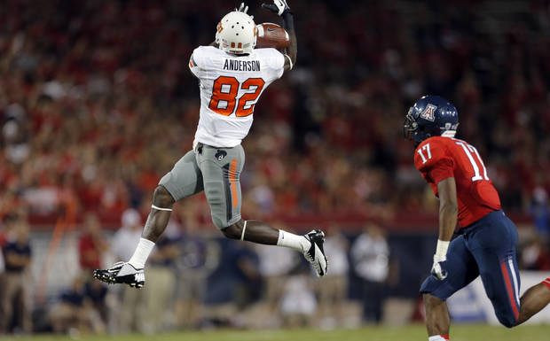 Oklahoma State's Isaiah Anderson (82) misses a pass as Arizona's Derrick Rainey (17) defends during their game on Sept. 8. PHOTO BY SARAH PHIPPS, The Oklahoman