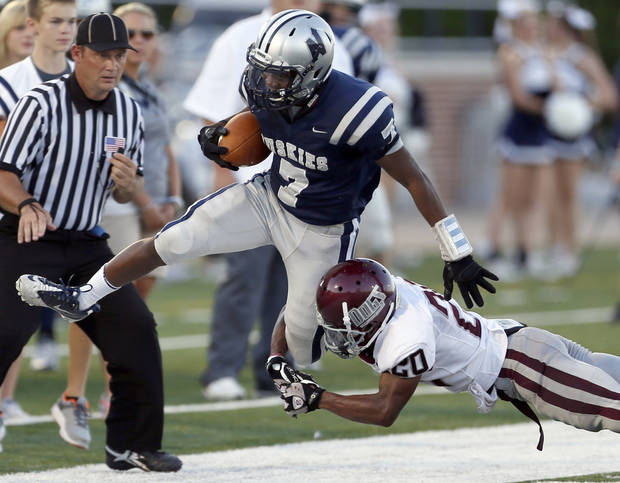 Edmond North's Marque Depp tries to get by Edmond Memorial's Tyren Lawson during the high school football game between Edmond North and Edmond Memorial at Wantland Stadium in Edmond, Okla., Friday, Aug. 31, 2012. Photo by Sarah Phipps, The Oklahoman
