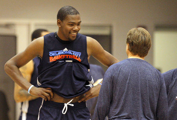 Oklahoma City's Kevin Durant talks with head coach Scott Brooks during Oklahoma City Thunder's practice at their new facility in Oklahoma City, Friday, Dec. 9, 2011. Photo by Sarah Phipps, The Oklahoman