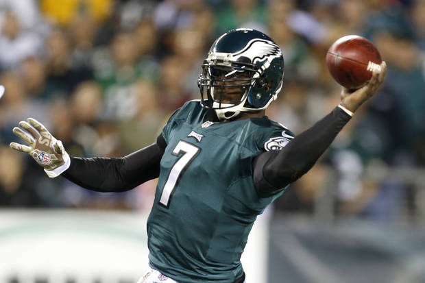 FILE - In this Nov. 11, 2012 file photo, Philadelphia Eagles quarterback Michael Vick throws a pass against the Dallas Cowboys in the first half of an NFL football game in Philadelphia. Vick, who was slated to earn $16 million next season, has agreed to a restructured deal with the Philadelphia Eagles. Vick, who was injured and inconsistent last season, eventually giving way to rookie Nick Foles, now has a three-year contract, and will compete with Foles to see who runs new coach Chip Kelly's offense this season. (AP Photo/Julio Cortez, File)