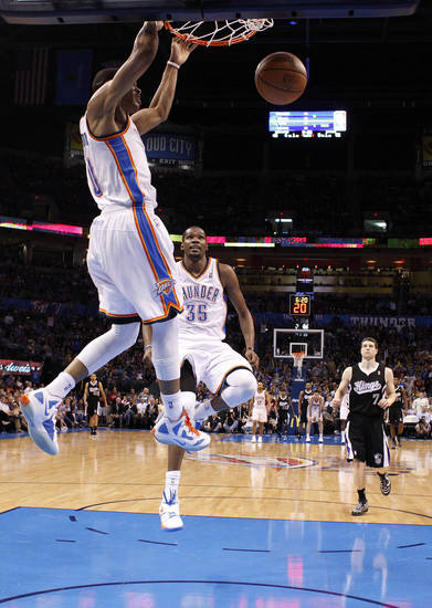 Oklahoma City's Russell Westbrook (0) dunks the ball as Kevin Durant (35) reacts during the NBA basketball game between the Oklahoma City Thunder and the Sacramento Kings at Chesapeake Energy Arena in Oklahoma City, Tuesday, April 24, 2012. Photo by Sarah Phipps, The Oklahoman.