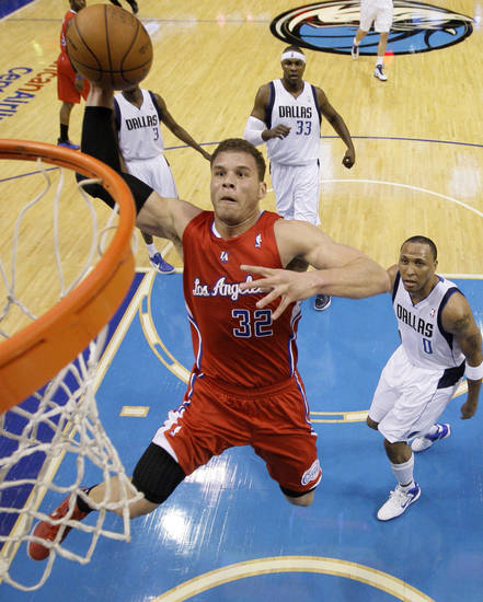 Los Angeles Clippers' Blake Griffin (32) goes in for a dunk as Dallas Mavericks' Shawn Marion (0) watches during the first half of an NBA basketball game Monday, April 2, 2012, in Dallas. (AP Photo/Tony Gutierrez) ORG XMIT: DNA105
