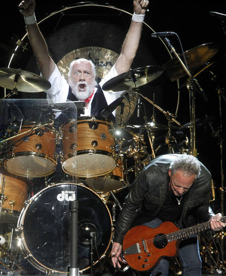 Drummer Mick Fleetwood and guitarist Lindsey Buckingham perform during a Fleetwood Mac concert at Madison Square Garden, Monday, April 8, 2013, in New York. (Photo by Jason DeCrow/Invision/AP) ORG XMIT: NYJD101