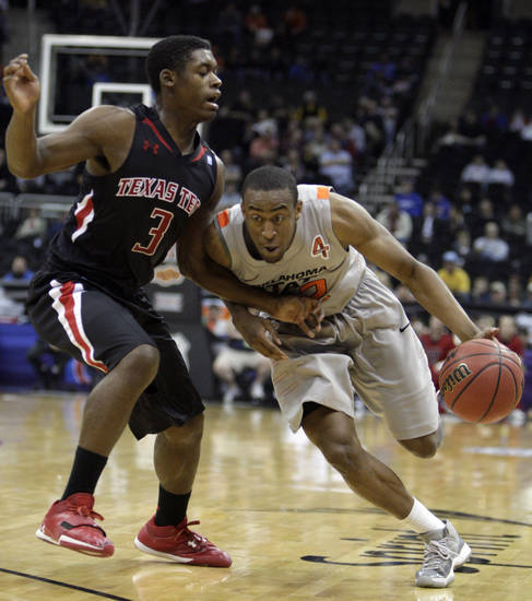 Oklahoma State's Markel Brown (22) tries to get by Texas Tech's DeShon Minnis (3) during the Big 12 tournament men's basketball game between the Oklahoma State Cowboys and the Texas Tech Red Raiders at the Sprint Center, Wednesday, March, 6, 2012. Photo by Sarah Phipps, The Oklahoman