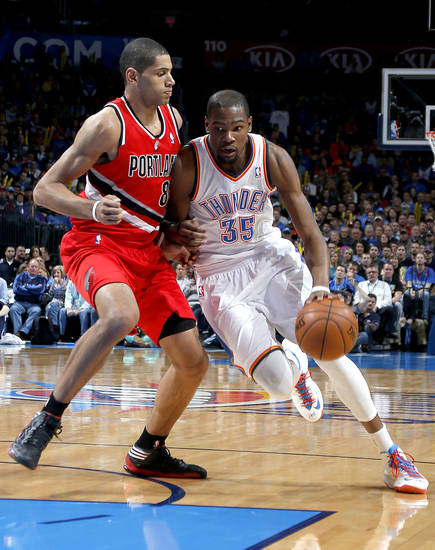 Oklahoma City's Kevin Durant (35) drives past Portland's Nicolas Batum (88) during the NBA basketball game between the Oklahoma City Thunder and the Portland Trail Blazers at the Chesapeake Energy Arena in Oklahoma City, Sunday, March, 24, 2013. Photo by Sarah Phipps, The Oklahoman