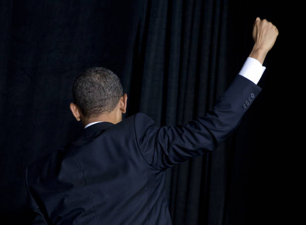 President Barack Obama turns to leave after shaking hands and speaking about immigration at Del Sol High School, Tuesday, Jan. 29, 2013, in Las Vegas. (AP Photo/Carolyn Kaster)