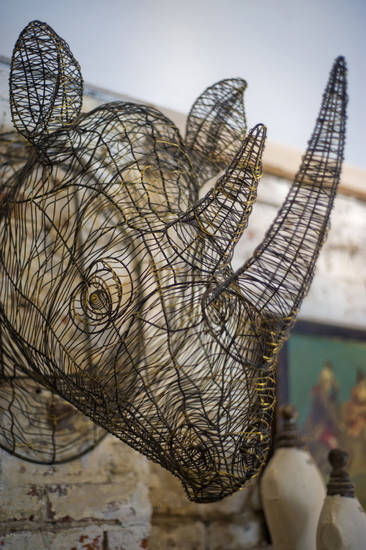 A wire rhinoceros hangs from the bedroom wall of Christian Siriano's New York City apartment, September 11, 2012. (Karl Merton Ferron/Baltimore Sun/MCT)