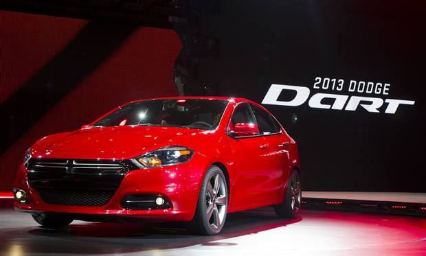 The 2013 Dodge Dart is unveiled Jan. 9 at the North American International Auto Show in Detroit. The Dart, unveiled with much fanfare at last year's Detroit auto show, got off to a slow start after going on sale in May 2012. Only 25,000 have sold. AP Photo <strong>TONY DING</strong>