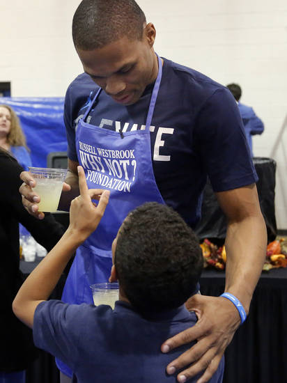 OKLAHOMA CITY THUNDER NBA BASKETBALL PLAYER / CHARITY / CHILD / CHILDREN / KIDS: Oklahoma City's Russell Westbrook talks with Caleb Bush ,10, during a Thanksgiving dinner at the Boys & Girls Club of Oklahoma County in Oklahoma CIty,  Tuesday, Nov. 20, 2012. Photo by Sarah Phipps, The Oklahoman