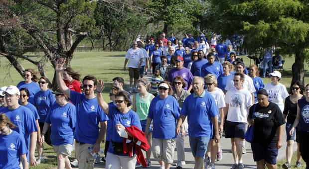 Supporters took part in a NAMI Oklahoma fundraising walk in May. The organization has several events scheduled for national Mental Illness Awareness Week, Oct. 7-13. Photo by PAUL HELLSTERN, The Oklahoman Archives