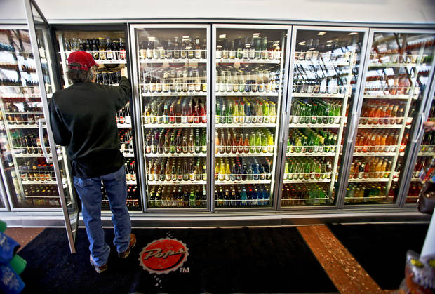 Tim Sumpter picks out his favorite sodas at Pops on Tuesday, Feb. 9, 2010, in Arcadia, Okla. The late Aubrey McClendon owned the store. Photo by Chris Landsberger, The Oklahoman