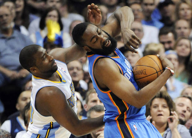 Denver Nuggets guard Raymond Felton (20) knocks the ball from the hands of Oklahoma City Thunder guard James Harden (13) during the first half in game 4 of a first-round NBA basketball playoff series Monday, April 25, 2011, in Denver. (AP Photo/Jack Dempsey)