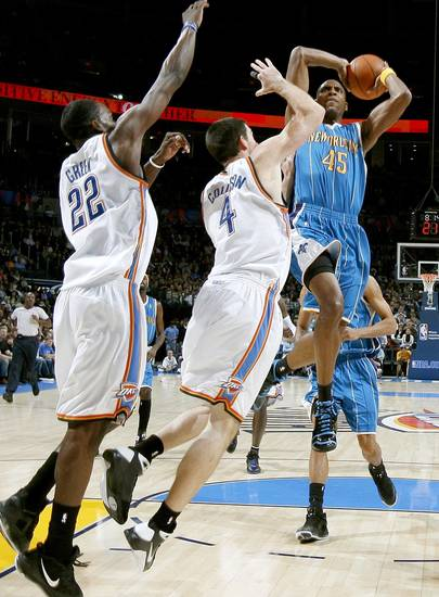 Rasual Butler of New Orleans drives to the basket by Oklahoma City's Nick Collison, center, and Jeff Green during the NBA basketball game between the Oklahoma City Thunder and the New Orleans Hornets at the Ford Center in Oklahoma City on Friday, Nov. 21, 2008.   BY BRYAN TERRY, THE OKLAHOMAN