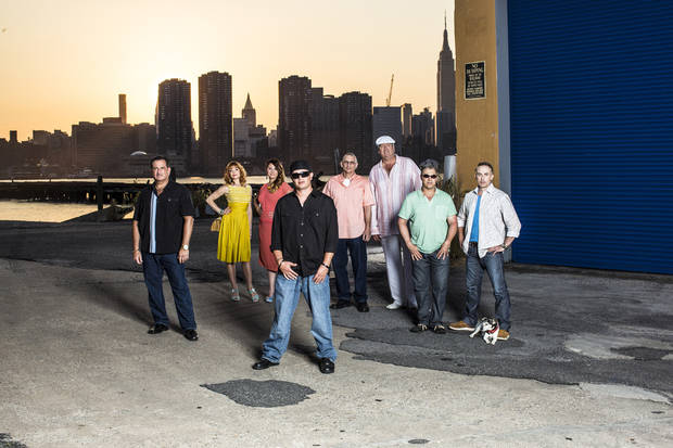 "From left, John Luke, Candy Olsen, Courtney Wagner, Mike Braiotta, Joe ""Joe P"" Pauletich, Big Steve Valenti, Chris Morelli and Tad Eaton star in A&E's ""Storage Wars: New York."" Photo by A&E Copyright 2013"