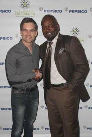 NASCAR driver Jeff Gordon and Pro Football Hall of Famer Emmitt Smith shake hands during the event.