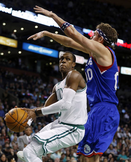 Boston Celtics' Rajon Rondo, left, moves against Philadelphia 76ers' Spencer Hawes during the second quarter of an NBA basketball game in Boston, Friday, Nov. 9, 2012. (AP Photo/Michael Dwyer)
