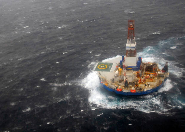 In this photo provided by the U.S. Coast Guard, the mobile drilling unit Kulluk is towed by the tugs Aiviq and Nanuq in 29 mph winds and 20-foot seas 116 miles southwest of Kodiak City, Alaska, Sunday, Dec. 30, 2012. The crews remain stationed with the drill rig Kulluk Sunday 20 miles from Alaska&#039;s Kodiak Island as they wait in rough seas for another tug boat to arrive. The Coast Guard says the goal is to tow the Kulluk to a safe harbor and determine the next step. (AP Photo/U.S Coast Guard, Chris Usher)