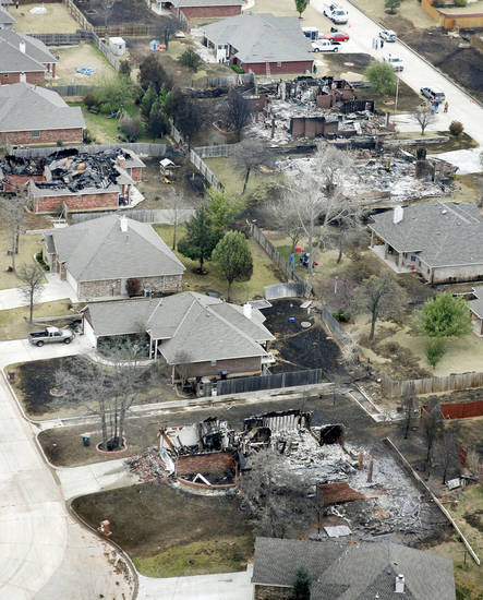 Fire destroyed a number of homes in this neighborhood in Midwest City, OK, Friday, April 10, 2009. By Paul Hellstern, The Oklahoman