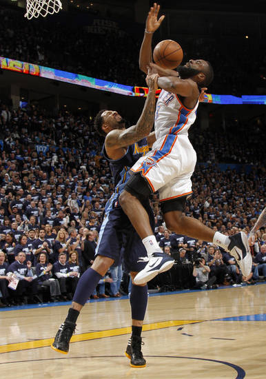 Oklahoma City's James Harden (13) is fouled by Denver's Wilson Chandler (21) during the NBA basketball game between the Denver Nuggets and the Oklahoma City Thunder in the first round of the NBA playoffs at the Oklahoma City Arena, Wednesday, April 27, 2011. Photo by Bryan Terry, The Oklahoman