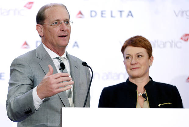 Delta Airlines CEO Richard Anderson speaks while Virgin Atlantic CCO Julie Southern listens during a news conference in New York, Tuesday, Dec. 11, 2012. Delta Air Lines said it will buy almost half of Virgin Atlantic for $360 million as it tries to catch up to rivals in the lucrative New York-to-London travel market. (AP Photo/Seth Wenig)