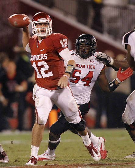 Texas Tech's Dartwan Bush (54) puts pressure on Oklahoma's Landry Jones (12) during the college football game between the University of Oklahoma Sooners (OU) and Texas Tech University Red Raiders (TTU) at the Gaylord Family-Oklahoma Memorial Stadium on Sunday, Oct. 23, 2011. in Norman, Okla. Photo by Chris Landsberger, The Oklahoman