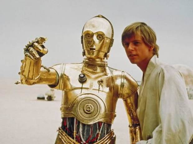 "Mark Hamill, right, portrays the character Luke Skywalker in this scene from the initial "" Star Wars"" release, with the droll droid C-3PO in this undated photo released by Lucasfilm Ltd."