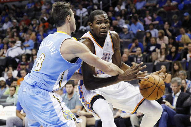 Denver Nuggets forward Danilo Gallinari (8) knocks the ball away from Oklahoma City Thunder forward Kevin Durant (35) in the third quarter of an NBA basketball preseason game in Oklahoma City, Sunday, Oct. 21, 2012. Oklahoma City won 108-101. (AP Photo/Sue Ogrocki)