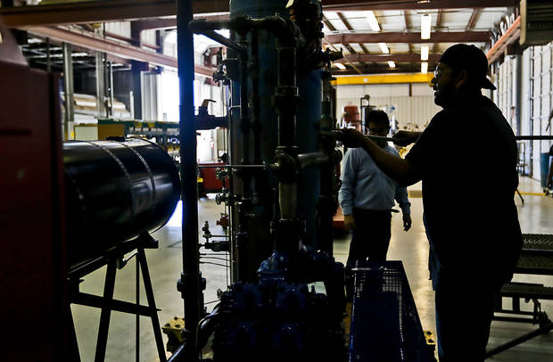 Employee Chris Hernandez works on a pump unit at Compressco Partners LP in Oklahoma City.