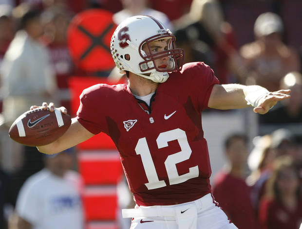 FILE - In this Nov. 7, 2009, file photo, Stanford quarterback Andrew Luck throws a pass against Oregon during the second quarter of an NCAA college football game in Stanford, Calif. _Jim Harbaugh's first recruiting trip as Stanford's football coach was to Texas to visit Andrew Luck even though it would be more than a year before the quarterback could arrive on campus. Now, Luck has the No. 14 Cardinal in contention for a Rose Bowl bid. (AP Photo/Marcio Jose Sanchez, File) ORG XMIT: NY168