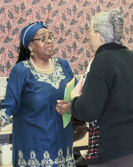 Marcia Muhammad, left, talks to Oklahoma City School Board Chairwoman Angela Monson after a hearing Tuesday morning at the Oklahoma County Election Board. Monson challenged Muhammad&acirc;s eligibility to run for the at-large position of board chairman, and the election board ruled Muhammad&acirc;s name could not appear on the ballot because of her criminal record.  PHOTO BY  CARRIE COPPERNOLL, THE OKLAHOMAN
