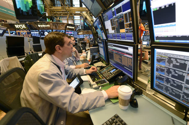 Traders work Wednesday on the floor of the New York Stock Exchange in New York. AP Photo