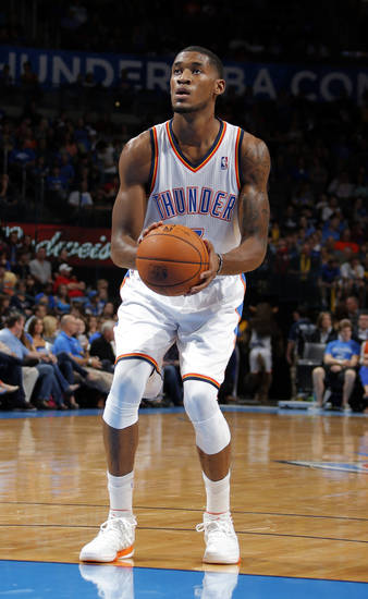 Oklahoma City's Perry Jones III (3) shoots a free throw during the preseason NBA game between the Oklahoma City Thunder and the Charlotte Bobcats at Chesapeake Energy Arena in Oklahoma City, Tuesday, Oct. 16, 2012. Photo by Sarah Phipps, The Oklahoman