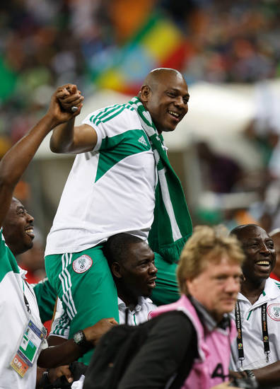 Nigeria's head coach Stephen Keshi is carried on shoulders after they defeated Burkina Faso in the final to win the African Cup of Nations at the Soccer City Stadium in Johannesburg, South Africa, Sunday, Feb. 10 2013. (AP Photo/Armando Franca)