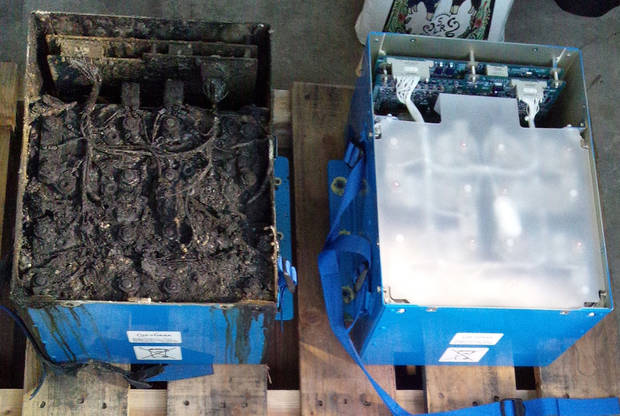 FILE - In this Thursday, Jan. 17, 2013 photo provided by the Japan Transport Safety Board shows the distorted main lithium-ion battery, left, and an undamaged auxiliary battery of the All Nippon Airways' Boeing 787 which made an emergency landing on Wednesday, Jan. 16, 2013 at Takamatsu airport in Takamatsu, western Japan. Japan's transport safety agency says a lithium ion battery on a Boeing 787 that overheated during an All Nippon Airways flight earlier this month, prompting an emergency landing, was not overcharged.  (AP Photo/Japan Transport Safety Board) EDITORIAL USE ONLY, NO SALES