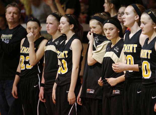 Members of the Cement girls basketball team stand before the start of a girls basketball game in Cement, Okla., Wednesday, January 30, 2014. Seth Martin, 15, collapsed during Tuesday's game and later died at the hospital. Photo by Bryan Terry, The Oklahoman