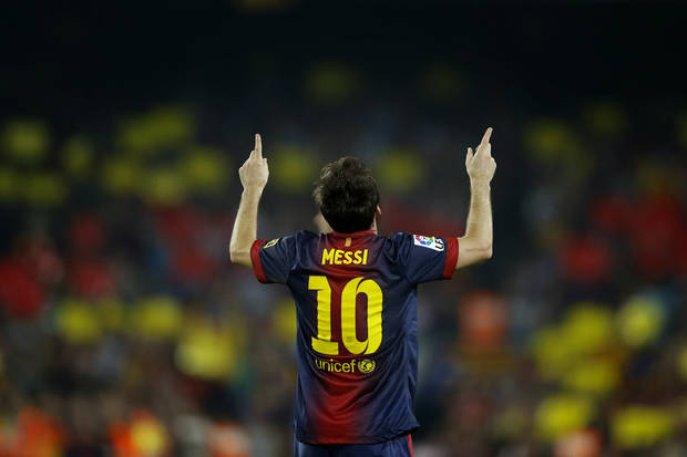 Barcelona's Lionel Messi from Argentina, right, celebrates after scoring a goal against Real Madrid's during a Spanish La Liga soccer match at the Camp Nou Stadium, in Barcelona, Sunday, Oct. 7, 2012. (AP Photo/Daniel Ochoa De Olza)