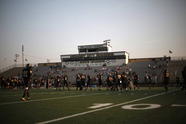 Midwest City practices before a high school football game between Midwest City and Norman North in Midwest City, Friday, Sept. 21, 2012.  Photo by Garett Fisbeck, The Oklahoman