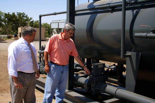 Shane Frye, Elk City's director of economic development, and Robert Lakey, chief financial officer and general counsel of Superior Fabrication Inc., inspect inspect equpment manufactured at Superior's Elk City plant. <strong></strong>