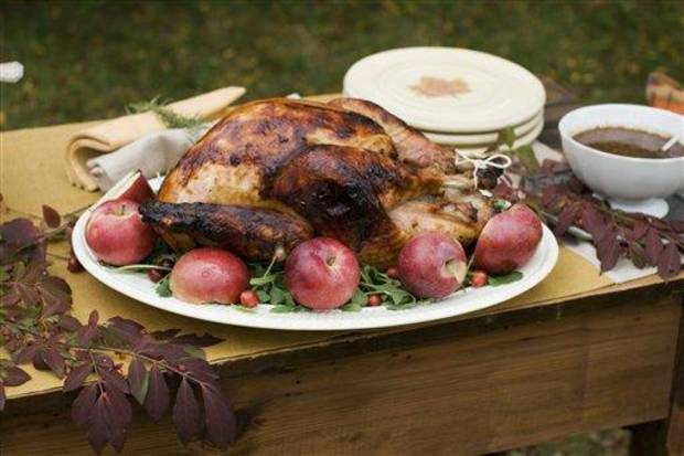 In this image taken on Oct. 8, 2012, cider brined turkey and sage gravy are shown in Concord, N.H. (AP Photo/Matthew Mead)