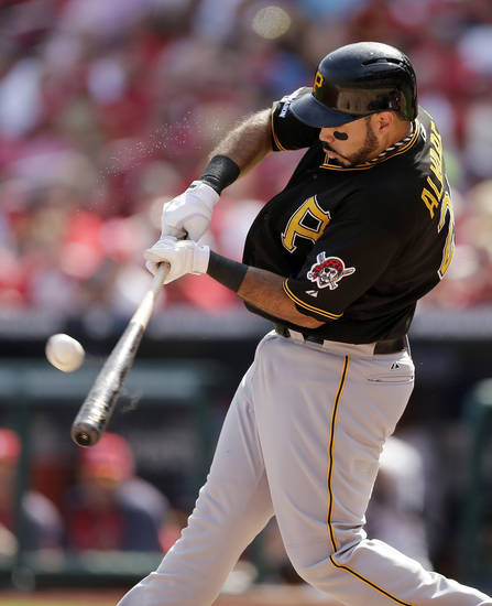 Pittsburgh Pirates' Pedro Alvarez hits a double against the St. Louis Cardinals in the second inning of Game 2 of baseball's National League division series on Friday, Oct. 4, 2013, in St. Louis. (AP Photo/Charlie Riedel)