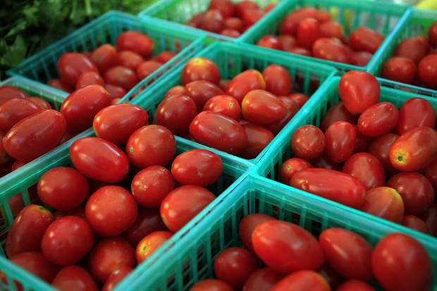 FILE - In this Wednesday, Nov. 7, 2012, file photo, tomatoes are sold at the Union Street Farmer's Market in downtown Gainesville, Fla. Cheaper gas drove down a measure of wholesale prices in November for the second straight month, a sign inflation remains in check. (AP Photo/The Gainesville Sun, Erica Brough)  THE INDEPENDENT FLORIDA ALLIGATOR OUT