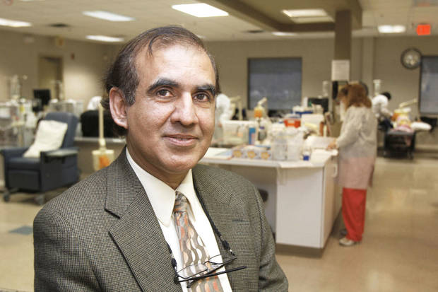 Dr. Zahid Ahmad discusses what it�s like to undergo dialysis at the Davita Dialysis Center in Oklahoma City. Ahmad is the medical director at Davita.  PHOTO BY PAUL HELLSTERN, THE OKLAHOMAN