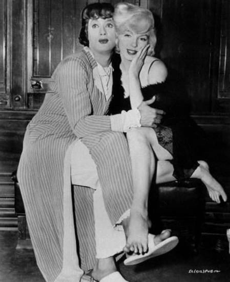 "Tony Curtis and Marilyn Monroe in ""Some Like It Hot."""