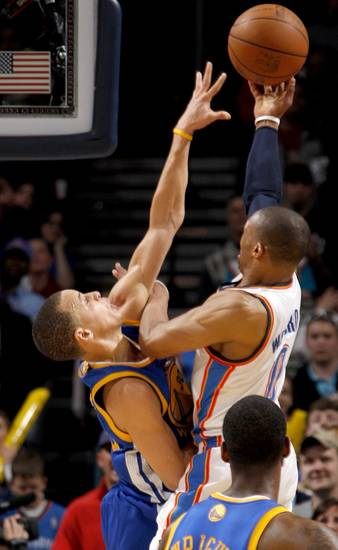 Oklahoma City's Russell Westbrook (0) is fouled by Golden State's Stephen Curry (30) near the end of overtime during the NBA basketball game between the Oklahoma City Thunder and the Golden State Warriors at the Oklahoma City Arena, Tuesday, March 29, 2011. Photo by Bryan Terry, The Oklahoman