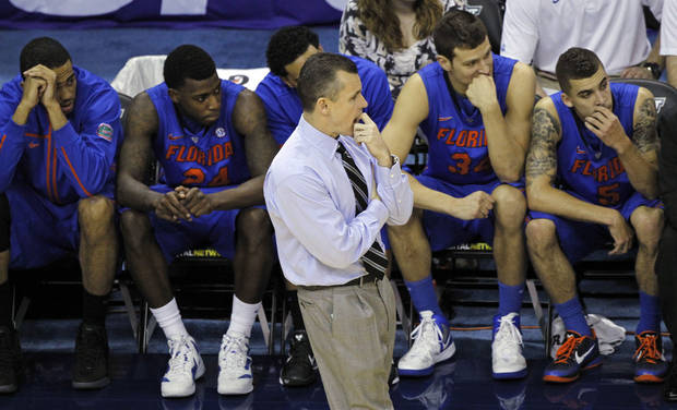 Florida head coach Billy Donovan and the Gator bench react near the end of a 74-71 loss to Kentucky in the second half of an NCAA college basketball game in the semi-final round of the 2012 Southeastern Conference tournament at the New Orleans Arena in New Orleans, Saturday, March 10, 2012. (AP Photo/Dave Martin)