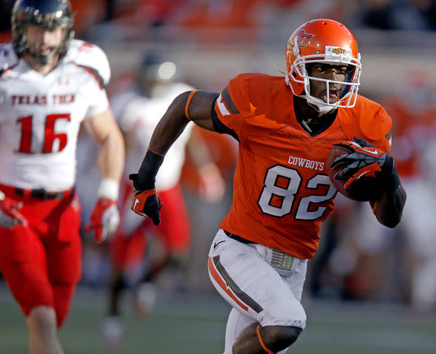 Oklahoma State&#039;s Isaiah Anderson (82) scores a touchdown during a college football game between Oklahoma State University (OSU) and Texas Tech University (TTU) at Boone Pickens Stadium in Stillwater, Okla., Saturday, Nov. 17, 2012.  Photo by Bryan Terry, The Oklahoman