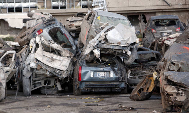Cars in the parking lot of Moore Medical Center were significantly damaged from Monday's tornado.  PHOTO BY STEVE SISNEY, THE OKLAHOMAN <strong>STEVE SISNEY</strong>