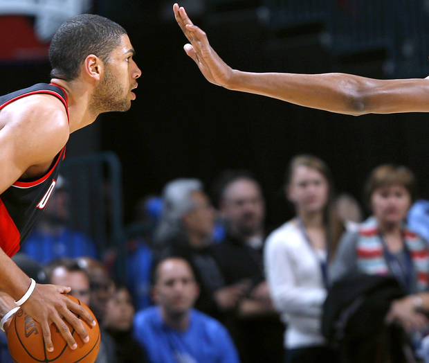 Portland's Nicolas Batum is pressured by Oklahoma City's Kevin Durant during their NBA basketball game at the Ford Center in Oklahoma City, Okla., on Sunday, March 28, 2010. Photo by John Clanton, The Oklahoman