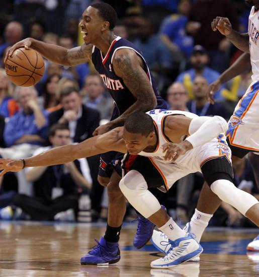 Oklahoma City Thunder's Russell Westbrook (0) tries to steal the ball from Atlanta Hawk's Jeff Teague (0) as the Atlanta Hawks defeat the Oklahoma City Thunder 104-95 in NBA basketball at the Chesapeake Energy Arena in Oklahoma City, on Sunday, Nov. 4, 2012.  Photo by Steve Sisney, The Oklahoman